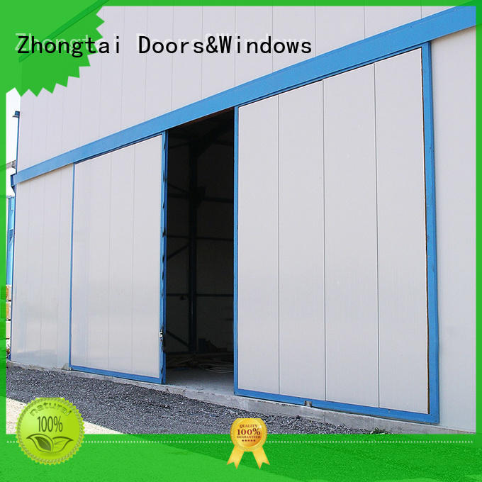Custom industrial sliding door overhead suppliers for warehouse