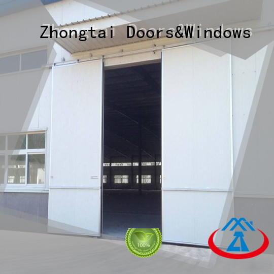 Custom industrial sliding door lifting company for warehouse